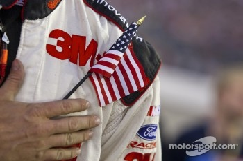 Greg Biffle, Roush Fenway Racing Ford holds an American flag