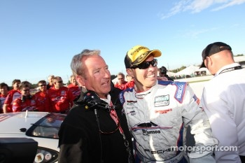GT 2011 champion Andrew Davis celebrates with Hurley Haywood