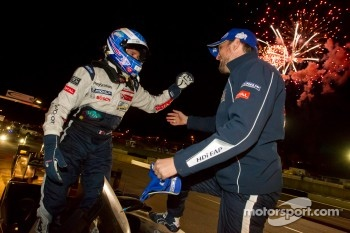 Race winners Stéphane Sarrazin and Franck Montagny celebrate