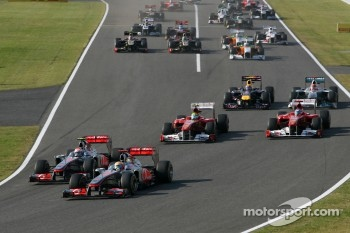 Start of the race, Jenson Button, McLaren Mercedes and Lewis Hamilton, McLaren Mercedes