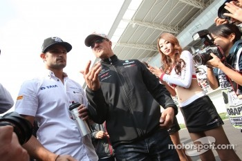 Vitantonio Liuzzi, HRT Formula One Team and Michael Schumacher, Mercedes GP Petronas F1 Team