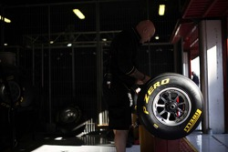 An engineer works on a Pirelli tyre