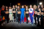 EJ Viso, Tanner Foust, A.J. Allmendinger and Ryan Briscoe pose with the trophy girls