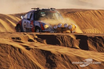 The Porsche struggling in the dunes