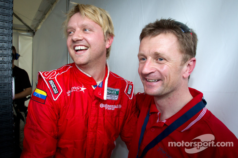 Pole winner Ryan Dalziel celebrates with Allan McNish