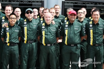 Riad Asmat, Caterham F1 Chief Executive Officer with Din Kamarudin, Caterham F1 Shareholder; Mike Gascoyne, Caterham Group Chief Technical Office; and Tony Fernandes, Caterham Team Principal at a Caterham F1 Team Photograph