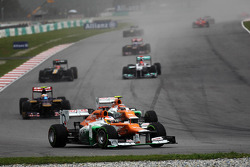 Paul di Resta, Sahara Force India leads Narain Karthikeyan, HRT Formula One Team HRT