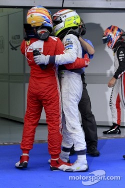 Race winner Fernando Alonso, Scuderia Ferrari and second place Sergio Perez, Sauber F1 Team