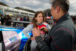 Cyndie Allemann talks with her engineer moments before the start