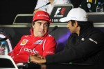 Fernando Alonso, Scuderia Ferrari with Narain Karthikeyan, Hispania Racing F1 Team, in the FIA Press Conference