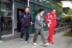 Christian Horner, Red Bull Racing Team Principal; Monisha Kaltenborn, Sauber F1 Team Managing Director and Stefano Domenicali, Scuderia Ferrari General Director leave a meeting of the teams concerning the upcoming Bahrain GP