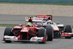 Felipe Massa, Ferrari leads Lewis Hamilton, McLaren