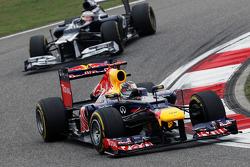 Sebastian Vettel, Red Bull Racing leads Pastor Maldonado, Williams