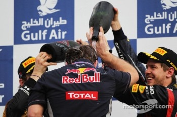 Christian Horner, Red Bull Racing Team Principal celebrates on the podium with Sebastian Vettel, Red Bull Racing and Kimi Raikkonen, Lotus F1 Team
