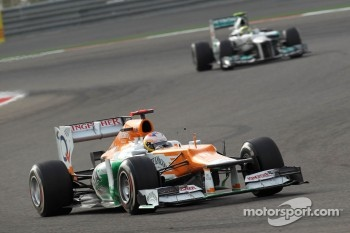 Paul di Resta, Sahara Force India Formula One Team leads Nico Rosberg, Mercedes AMG Petronas