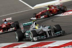 Nico Rosberg, Mercedes AMG Petronas leads Fernando Alonso, Scuderia Ferrari