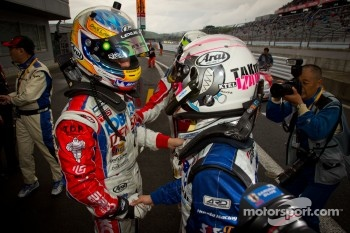 GT500 race winner Hiroaki Ishiura celebrates with Takuya Izawa