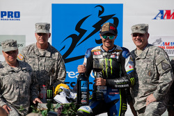Josh Hayes celebrates winning SuperBike Race #1 with members of the National Guard