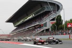 Fernando Alonso, Scuderia Ferrari passes pole sitter Pastor Maldonado, Williams at the start of the race