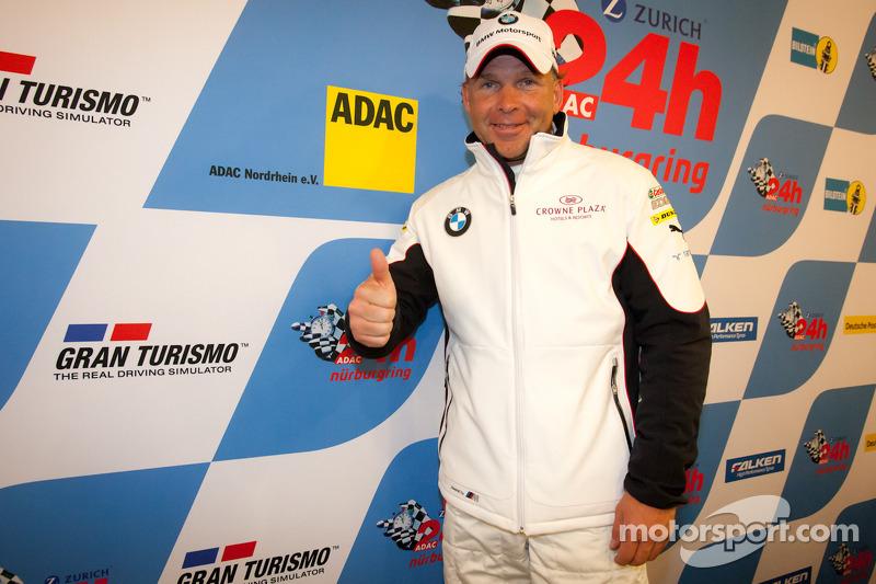 Pole winner Uwe Alzen celebrates