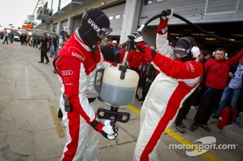 Audi race experience team members after a pit stop