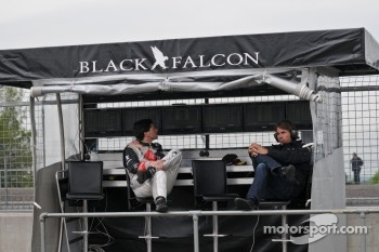 Busy Balck Falcon pitwall