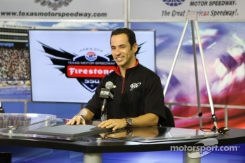 Helio Castroneves, blocking a sign…