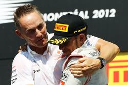 Race winner Lewis Hamilton, McLaren Mercedes celebrates on the podium with Martin Whitmarsh, McLaren Mercedes Chief Executive Officer