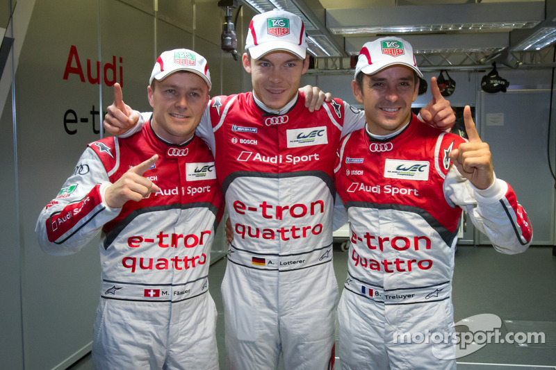 Pole winners Marcel Fässler, Andre Lotterer and Benoit Tréluyer celebrate