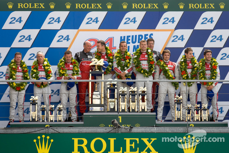LMP1 podium: class and overall winners Marcel Fässler, Andre Lotterer, Benoit Tréluyer, second place Rinaldo Capello, Tom Kristensen, Allan McNish, third place Oliver Jarvis, Marco Bonanomi, Mike Rockenfeller
