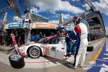 Pit stop for #83 JMB Racing Ferrari 458 Italia: Manuel Rodrigues, Philippe Illiano, Alain Fert