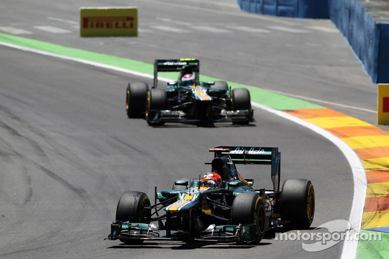 Heikki Kovalainen, Caterham leads team mate Vitaly Petrov, Caterham
