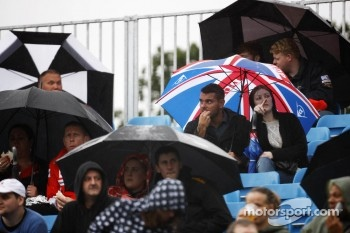Fans brave the rain in the grandstands
