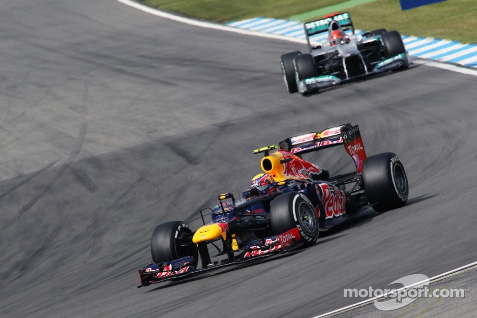Mark Webber, Red Bull Racing leads Michael Schumacher, Mercedes AMG F1