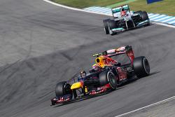 Mark Webber, Red Bull Racing leads Michael Schumacher, Mercedes AMG F1