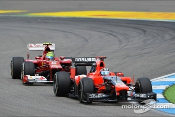 Timo Glock, Marussia F1 Team leads Felipe Massa, Ferrari