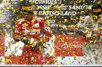 Podium: race winner Fernando Alonso, Ferrari, Jenson Button, McLaren, third