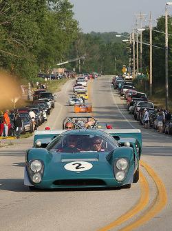 Race Cars parade into Elkhart Lake for the Friday Concours.  #2 1969 Lola MkIIIB : Johan Woerheide