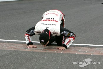 Brad Keselowski kisses the yard of bricks