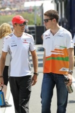 Jenson Button, McLaren with Paul di Resta, Sahara Force India F1