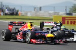 Mark Webber, Red Bull Racing and Bruno Senna, Williams battle for position at the start of the race