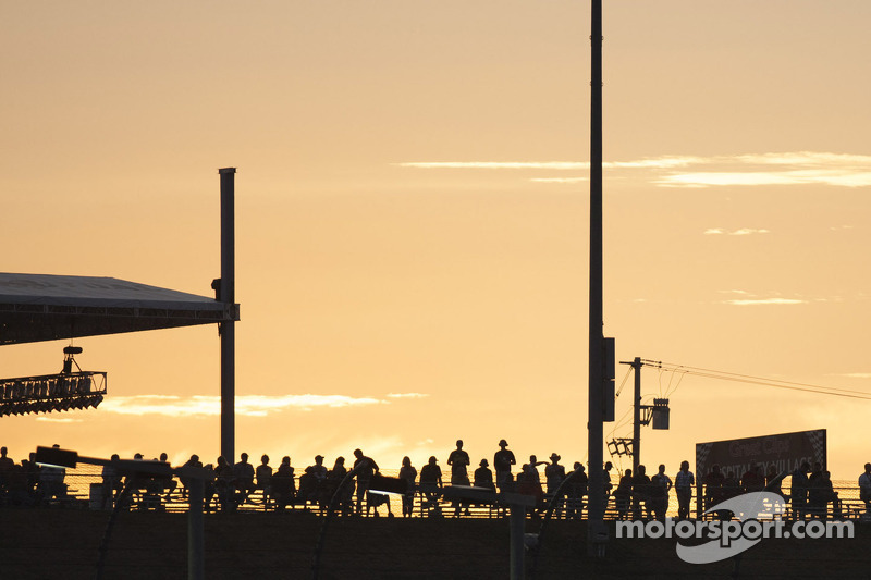 The sun sets over the fans