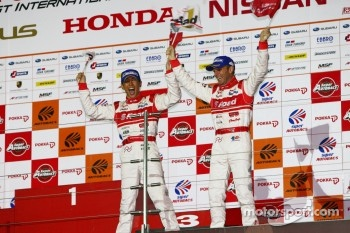 GT500 podium: winners Masataka Yanagida and Ronnie Quintarelli