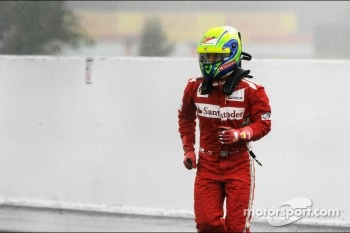 Felipe Massa, Ferrari stopped at the pitlane entrance in the first practice session and heads back to the pits