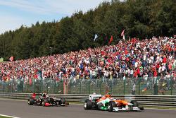 Nico Hulkenberg, Sahara Force India F1 leads Kimi Raikkonen, Lotus F1