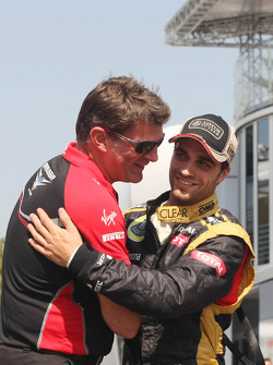 Graeme Lowdon, Marussia F1 Team Chief Executive Officer with Jérôme d'Ambrosio, Lotus F1 Team
