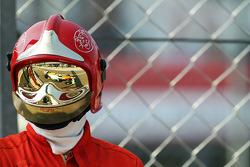 Nico Hulkenberg, Sahara Force India F1 in the reflection of a marshall's visor