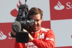 Podium: Fernando Alonso, Ferrari takes control of a FOM camera