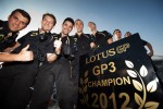 Lotus GP mechanics celebrate the 2012 Team Championship