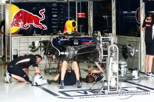 Red Bull Racing mechanics work on the Red Bull Racing in Singapore